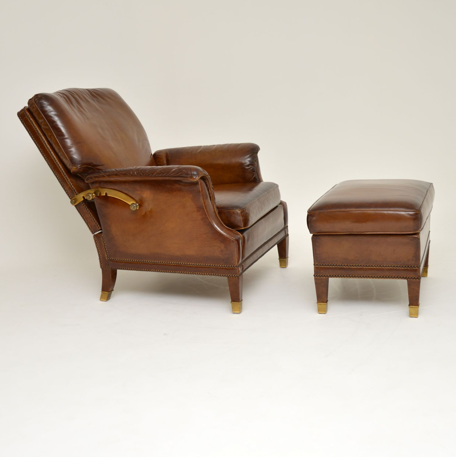 antique leather brass reclining armchair and stool