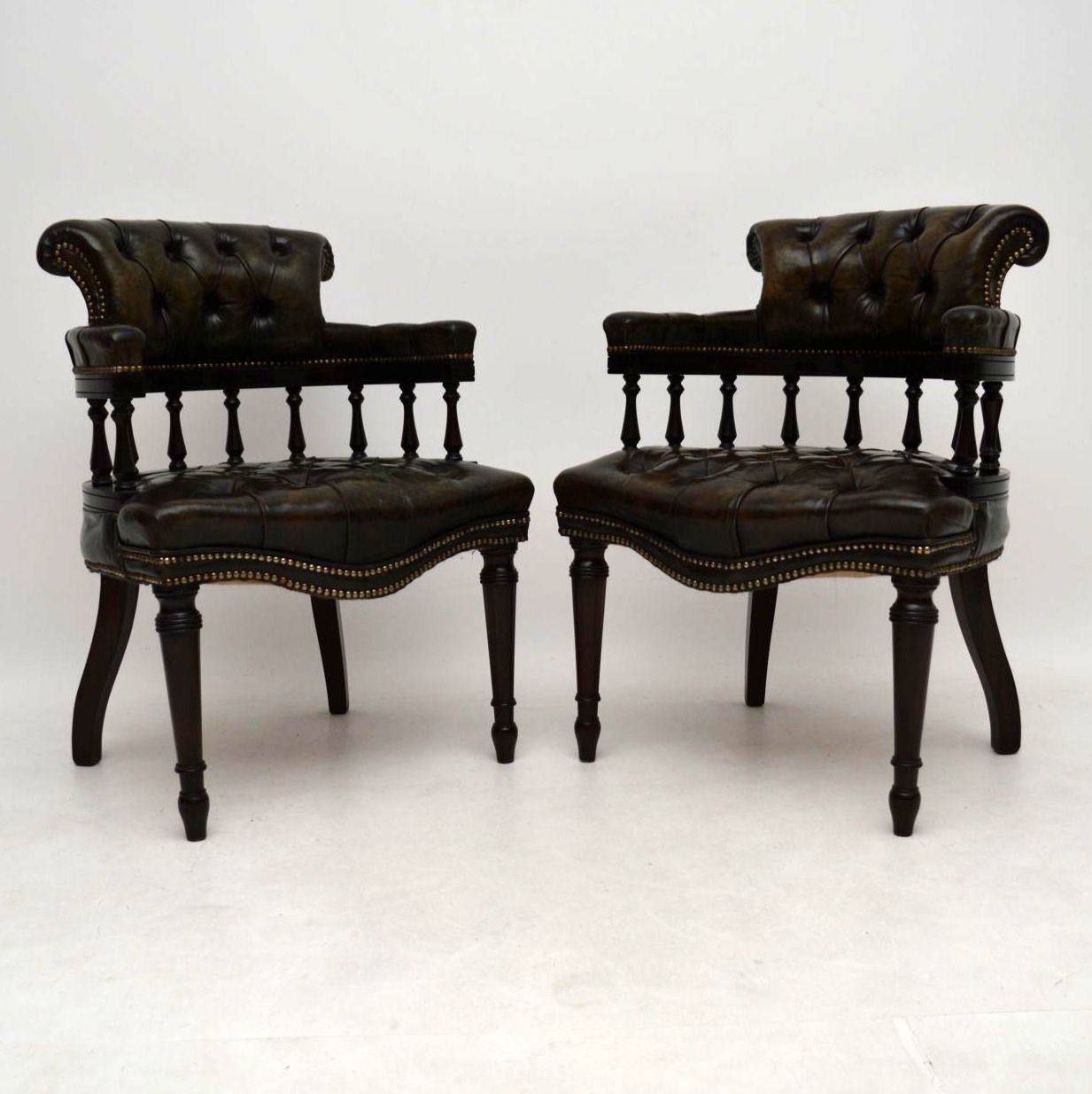 Pair of Antique Distressed Leather & Mahogany Armchairs