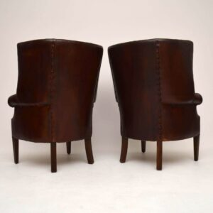 Pair of Antique Leather Porters Wing Armchairs