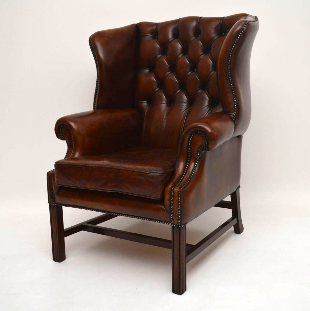 Antique Deep Buttoned Leather Wing Back Armchair