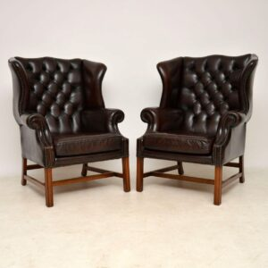 Pair of Antique Leather Wing Back Armchairs