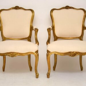 Pair of Antique French Gilt Wood Salon Cream Armchairs