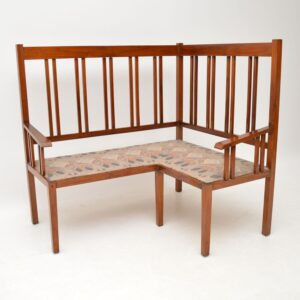 Antique Arts & Crafts Solid Walnut Corner Settee from Liberty of London