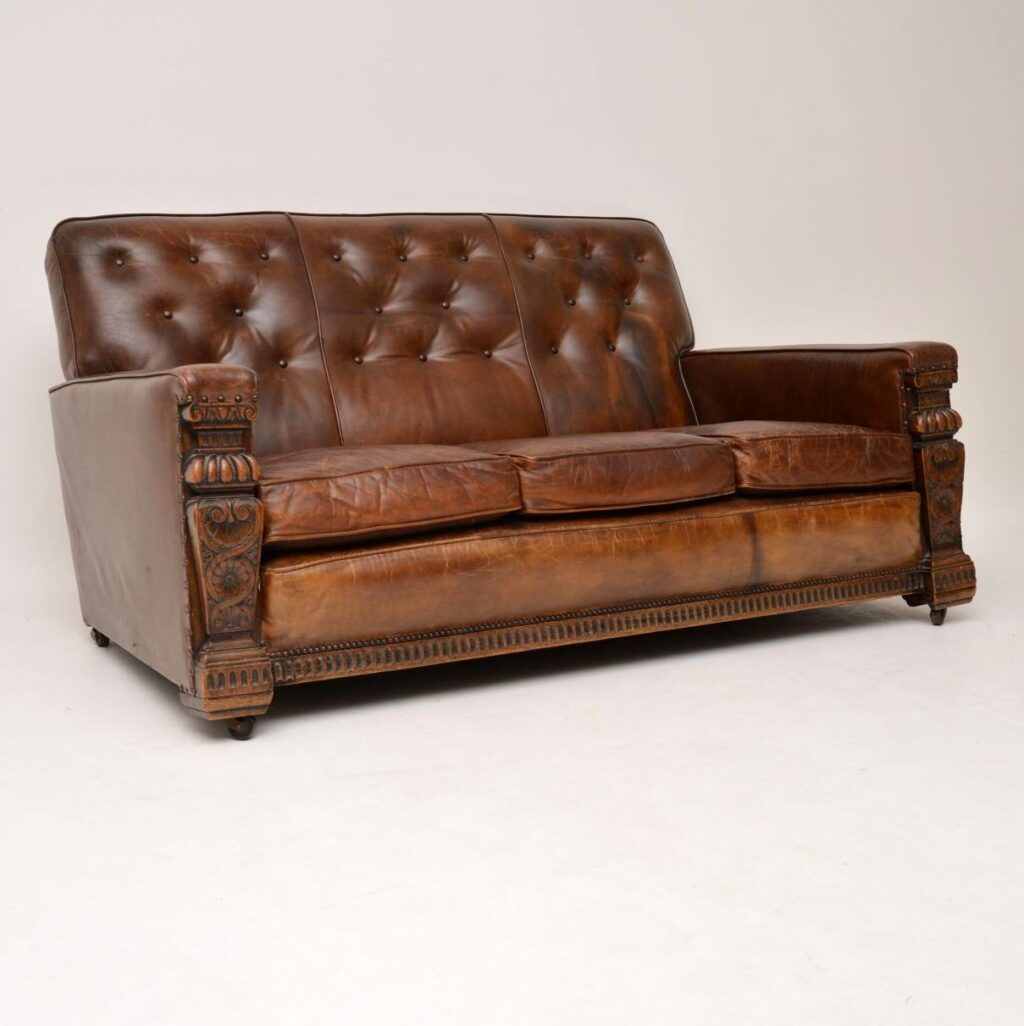 Antique Leather Upholstered Carved Oak Sofa