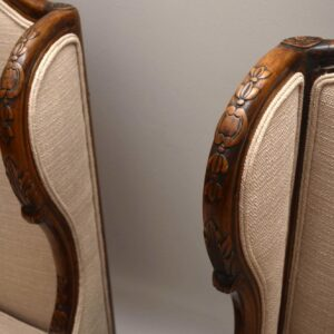 Pair of Antique Carved Mahogany Wing Back Armchairs