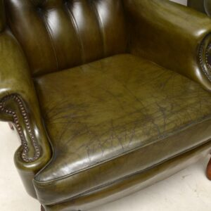 Pair of Antique Deep Buttoned Leather Wing Back Armchairs