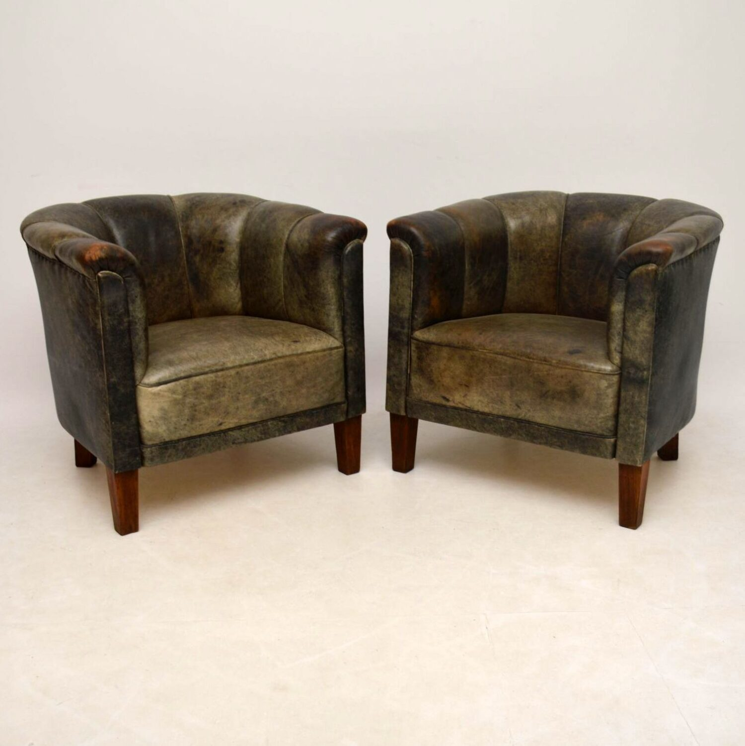 Pair of Antique Swedish Leather Tub Armchairs