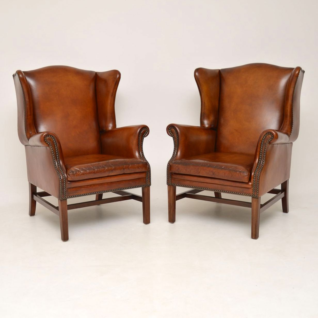 Pair of Antique Swedish Leather Wing Back Armchairs