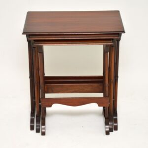 antique mahogany nest of three tables