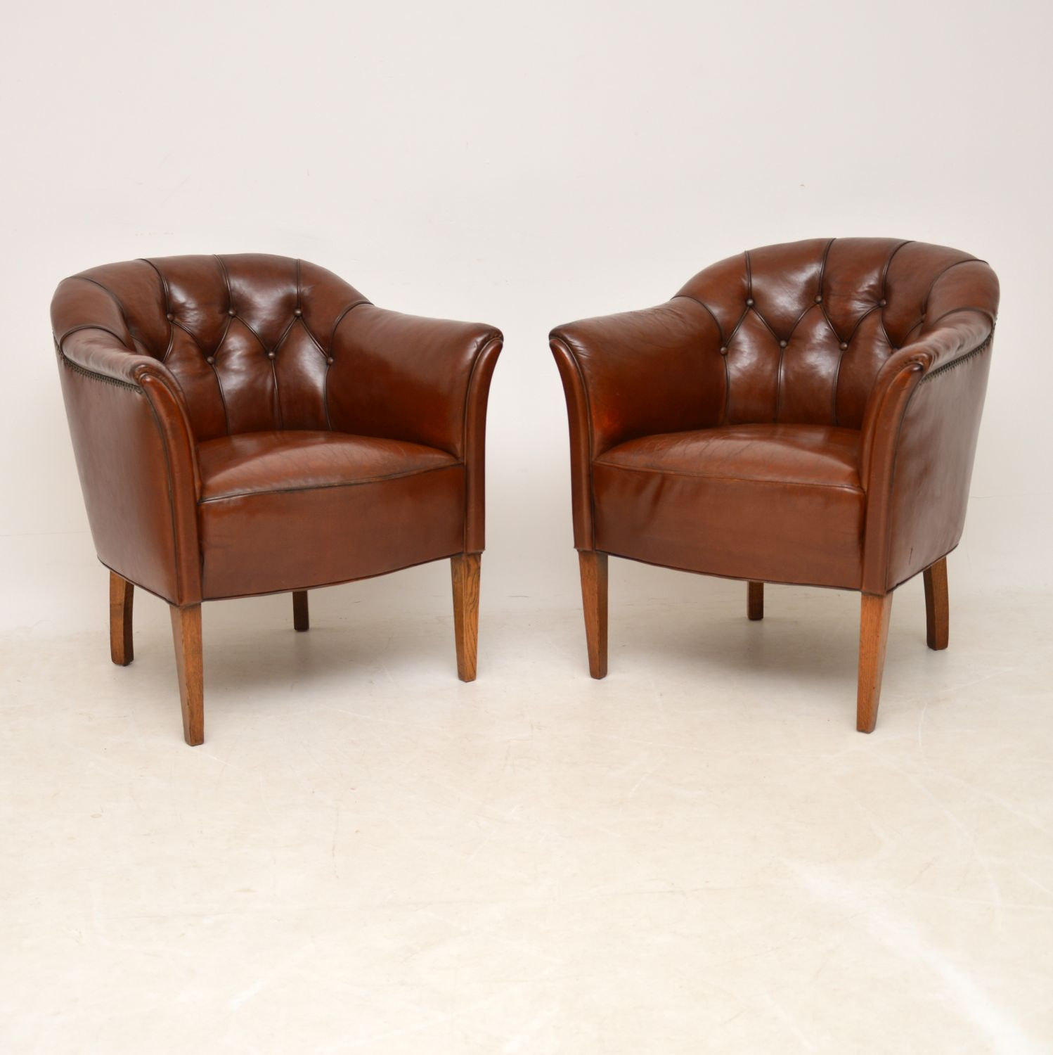 Pair of Antique Swedish Deep Buttoned Leather Armchairs
