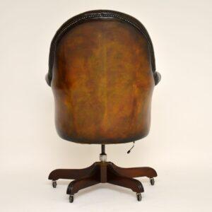 antique leather swivel armchair