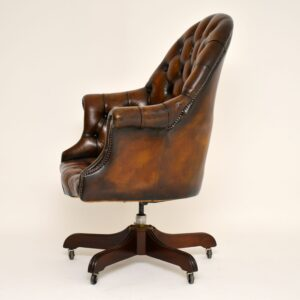 antique leather swivel armchair