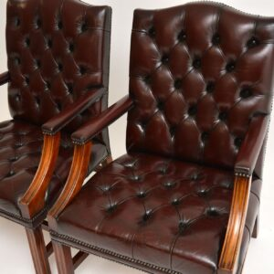 Pair of Antique Deep Buttoned Leather Library Armchairs