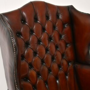 pair of antique leather mahogany wing back armchairs