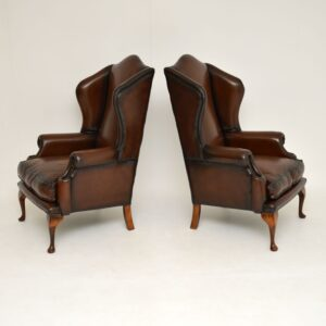 pair of antique georgian leather wing back armchairs
