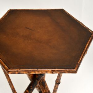antique victorian bamboo leather side tripod table