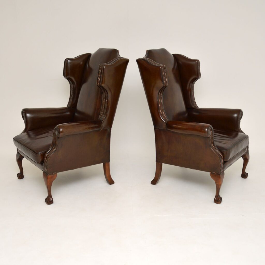 pair of antique georgian wing back leather armchairs
