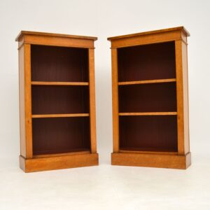 pair of antique birds eye maple open bookcases