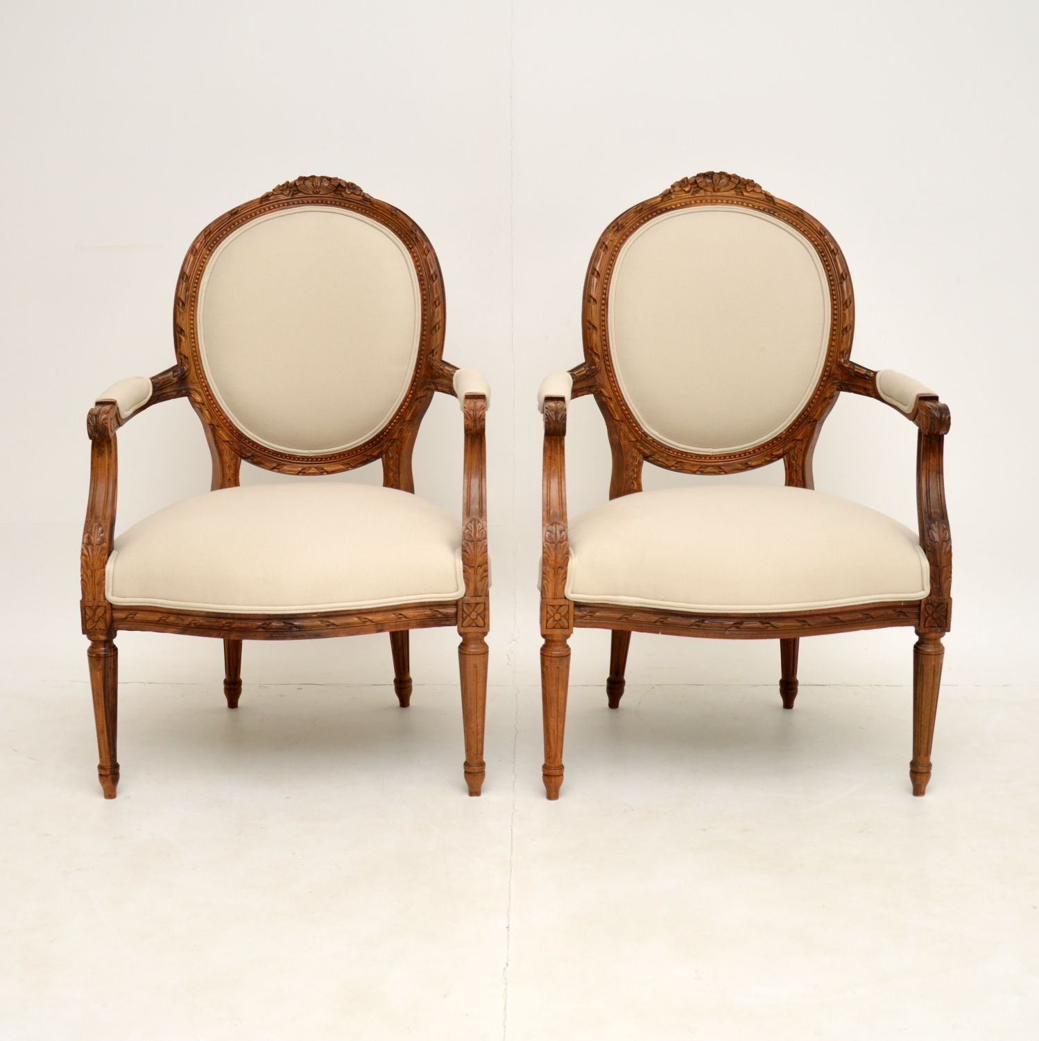 pair of antique french louis walnut salon armchairs
