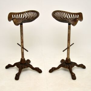 pair of antique victorian iron tractor bar stools