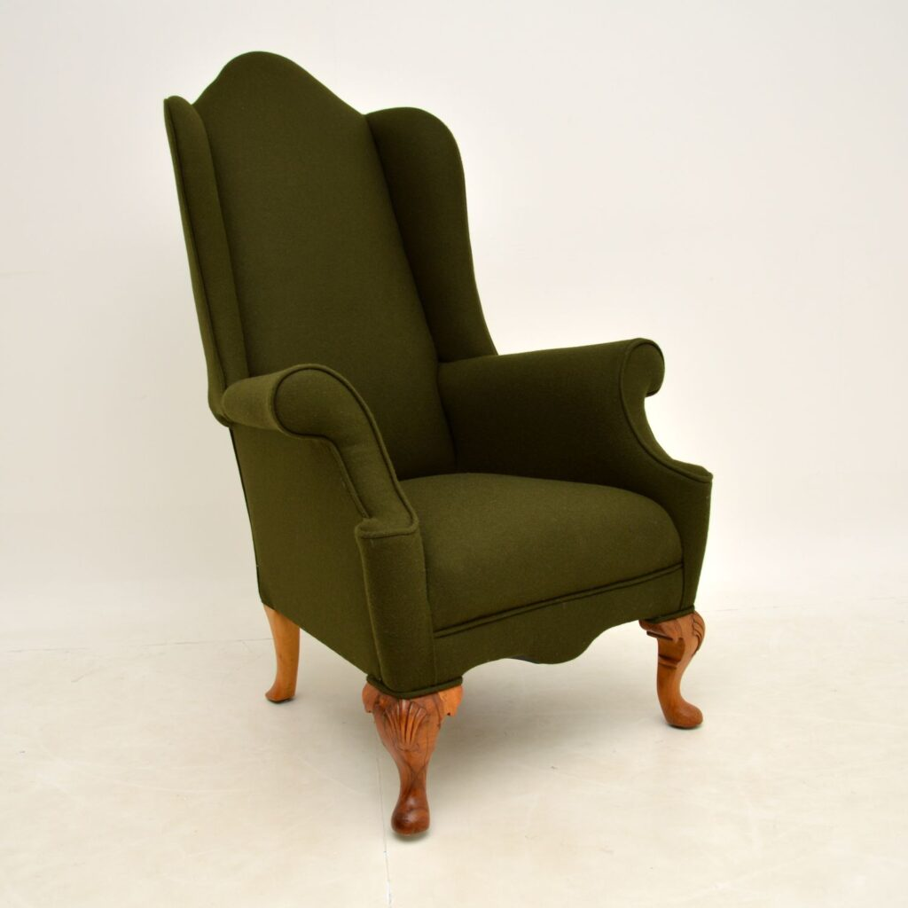 antique wing back wool armchair