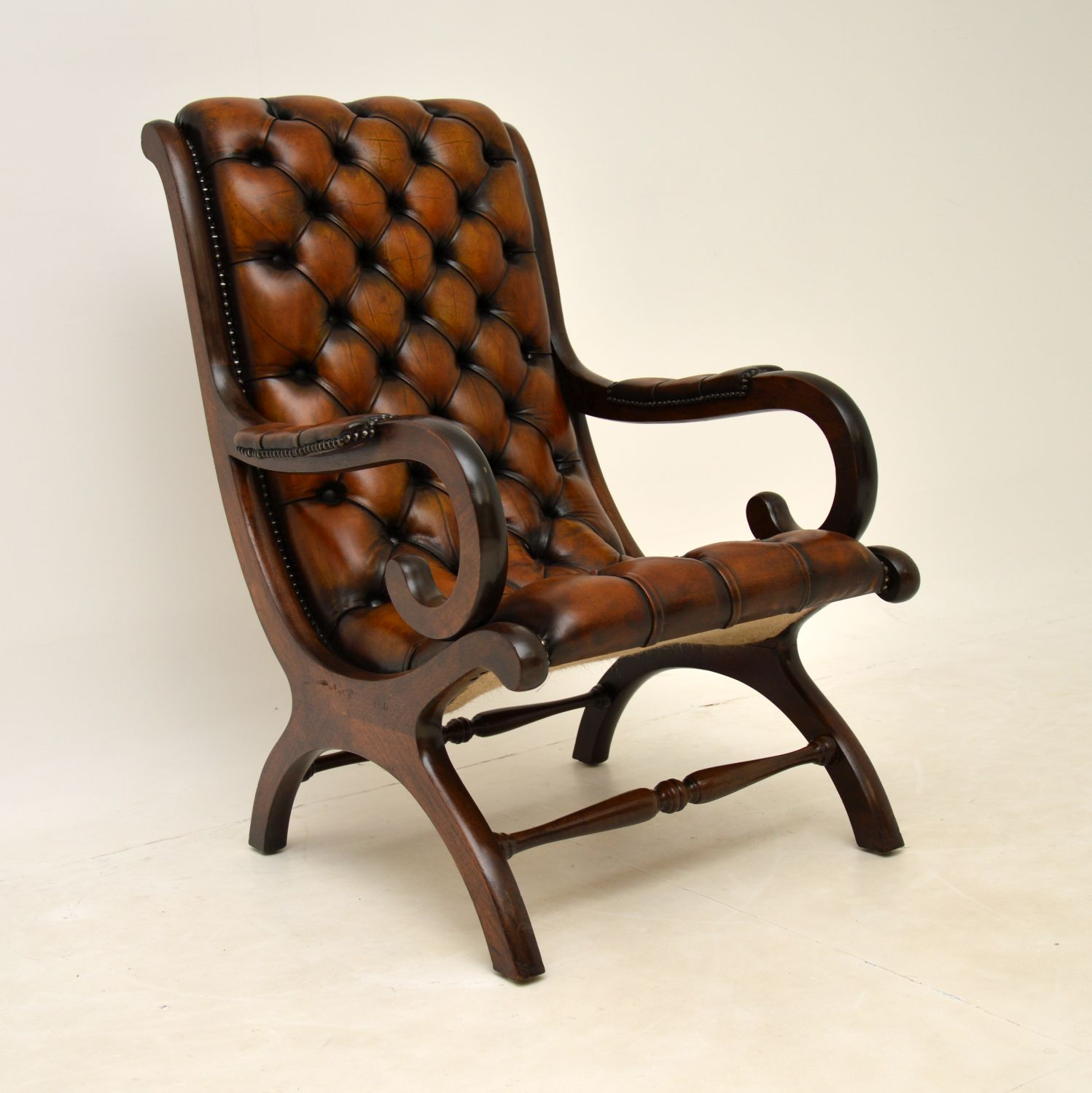 antique regency leather mahogany armchair and stool