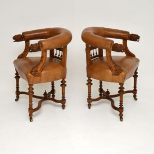 pair of antique carved oak leather armchairs