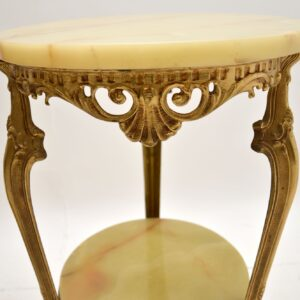 A beautifully made vintage side table in the antique French style. This was made in France, it dates from the 1930-50's. It is of great quality and is a very useful size. The onyx has a lovely colour tone and beautiful patters. The onyx is removable on the lower and upper surface. The condition is excellent for its age, with only some extremely minor wear here and there. We also have an identical matching pair of these, seen listed under our other items for sale.