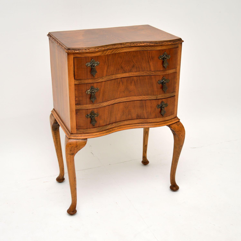 antique walnut serpentine chest on legs