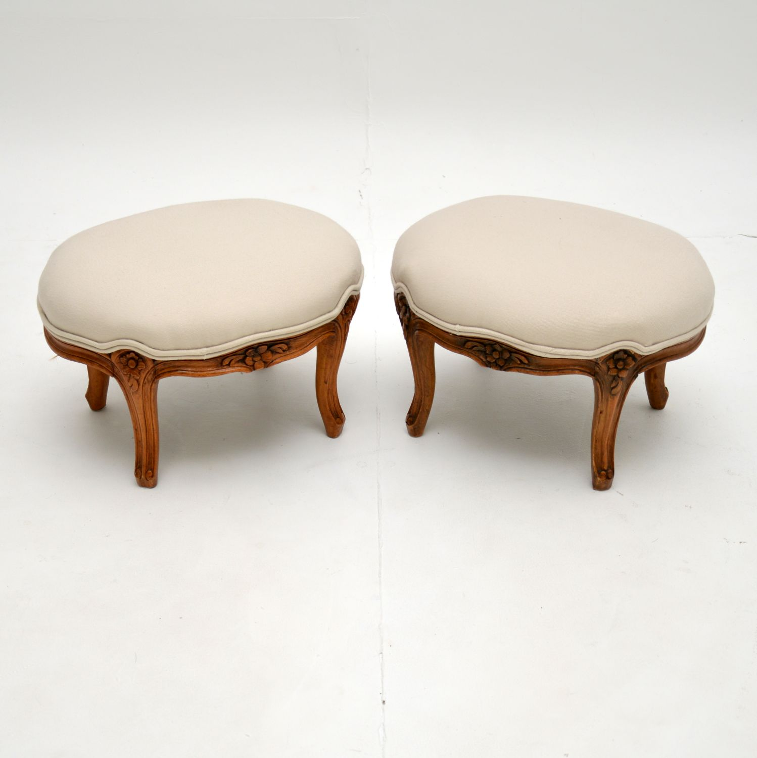pair of antique french carved walnut foot stools