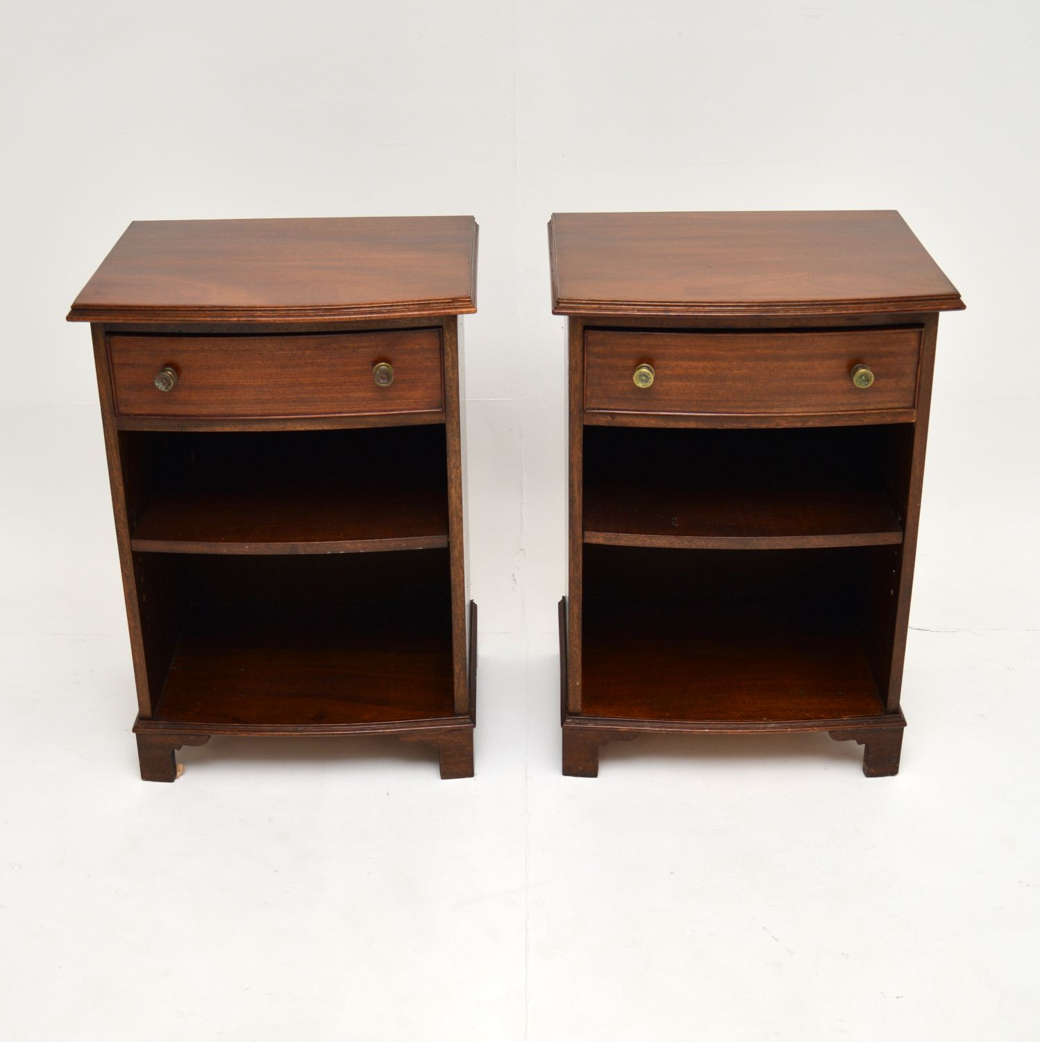 pair of antique edwardian mahogany bow front bedside cabinets