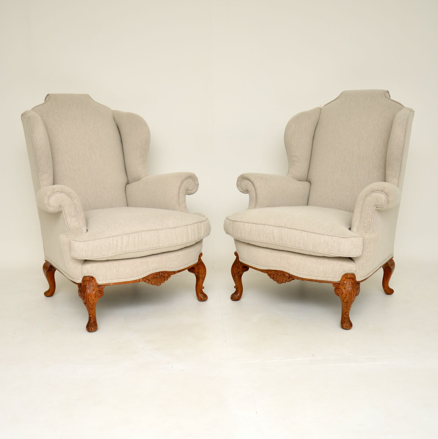 pair of antique queen anne walnut wing back armchairs
